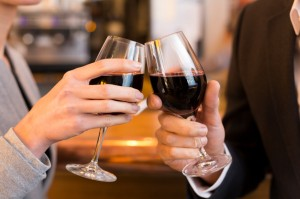 Close Up of Couple Toasting with red wine glass in restaurant