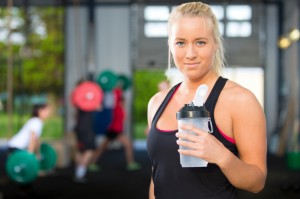 Attractive blonde woman rests at fitness gym
