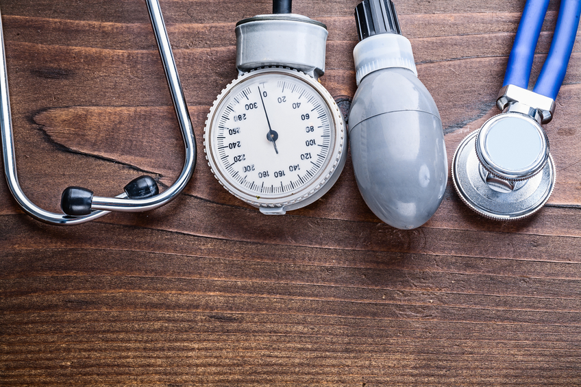 working elements of blood pressure monitor and stethoscope on v