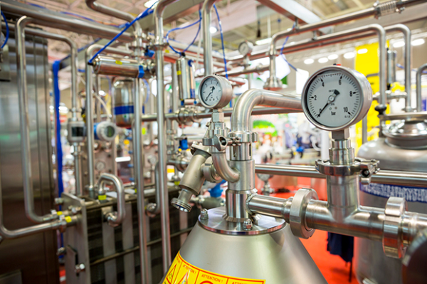 Sophisticated milk pasteurization equipment is used to make yogurt